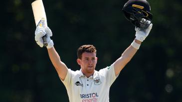 Ryan Higgins celebrates his reaching his century
