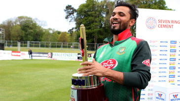 An elated Mashrafe Mortaza sports a grin with the tri-nation series trophy in hand