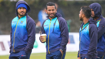 Dimuth Karunaratne has a cup of coffee to keep warm ahead of his ODI captaincy debut