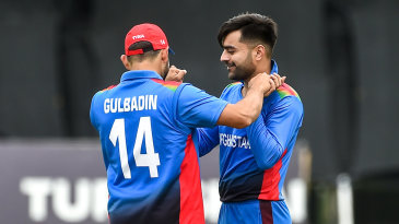 Rashid Khan is congratulated by Gulbadin Naib after taking a wicket