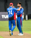 Rashid Khan is congratulated by Gulbadin Naib after taking a wicket, Ireland v Afghanistan, 1st ODI, Belfast, May 19, 2019