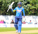 Dimuth Karunaratne raises his bat after reaching a half-century on his ODI captaincy debut, Scotland v Sri Lanka, 2nd ODI, Edinburgh, May 21, 2019
