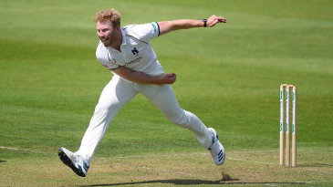 Liam Norwell of Warwickshire on his way to a seven-wicket haul