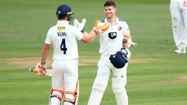 Sean Dickson is congratulated on his hundred
