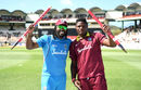 Oshane Thomas and Chris Gayle enjoy the victory celebration