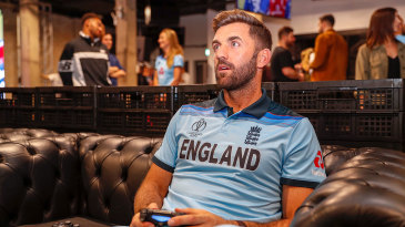 Liam Plunkett plays a video game at the England World Cup kit launch