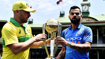 Aaron Finch and Virat Kohli pose with the World Cup