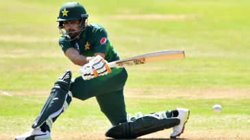 Babar Azam sweeps for a boundary