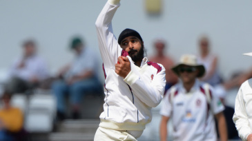 Monty Panesar bowls during his brief comeback with Northamptonshire