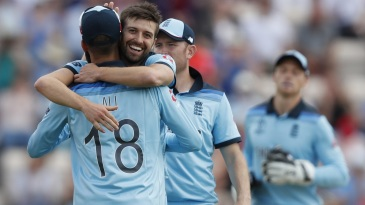 Mark Wood and Moeen Ali celebrate Aaron Finch's dismissal