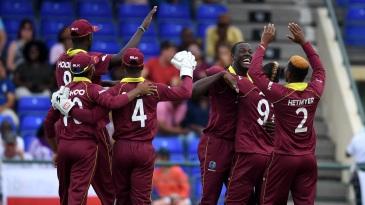 Carlos Brathwaite celebrates a wicket with his team-mates
