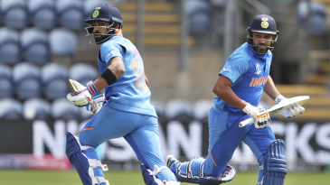 Rohit Sharma and Virat Kohli run during their second-wicket stand