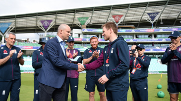 Eoin Morgan is presented his 200th ODI cap for England by Andrew Strauss