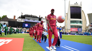 Jason Holder leads his team out