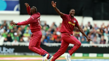 Jason Holder and Andre Russell celebrate Imad Wasim's wicket