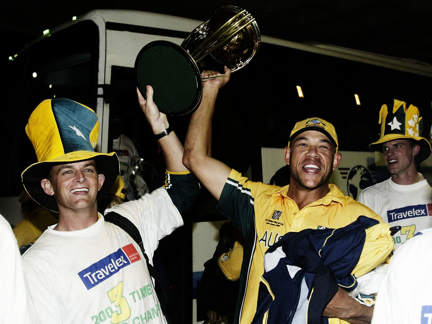 Adam Gilchrist and Andrew Symonds rejoice, not knowing what horrors await them on the flight back