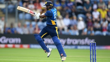 Kusal Perera punches the ball into the off side