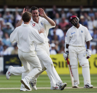 Ashley Giles celebrates as Brian Lara looks on disconsolately, England v West Indies, 1st Test, Lord's, 5th day, July 26, 2004