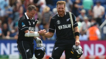 Colin Munro and Martin Guptill celebrate victory in their World Cup opener