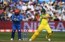 Aaron Finch punches the ball off the back foot as Mohammad Shahzad watches, Afghanistan v Australia, World Cup 2019, Bristol, June 1, 2019