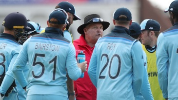 Marais Erasmus talks to the England players after Chris Woakes' catch of Imam-ul-Haq