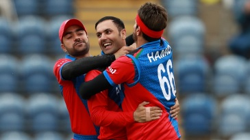 Mohammad Nabi, Rashid Khan and Hamid Hassan celebrate a wicket