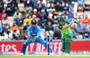 Chris Morris bats as MS Dhoni looks on,  India v South Africa, Southampton, World Cup 2019, June 5, 2019