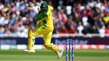 Usman Khawaja is hit on the head off the bowling of Oshane Thomas