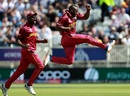 Andre Russell celebrates Usman Khawaja's wicket alongside Carlos Brathwaite, Australia v West Indies, World Cup 2019, Trent Bridge, June 6, 2019