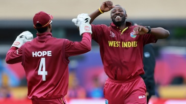 Andre Russell celebrates with Shai Hope