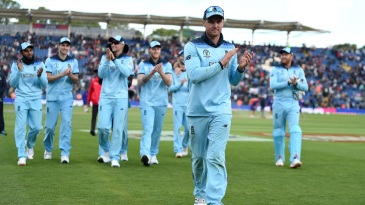 Jason Roy leads his team from the field after victory against Bangaladesh