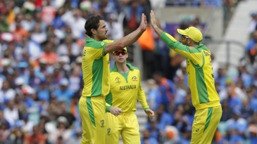 Nathan Coulter-Nile celebrates the wicket of Rohit Sharma