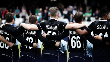 New Zealand players put their arms around each other for the national anthem