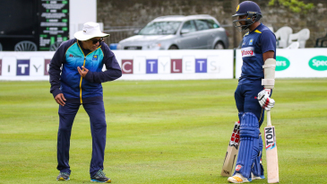 Chandika Hathurusingha helps Avishka Fernando work out a technical kink at training