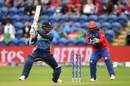 Dimuth Karunaratne sends one away watched by Mohammad Shahzad, seventh match,  World Cup 2019, Afghanistan v Sri Lanka, Cardiff, Wales, June 04, 2019