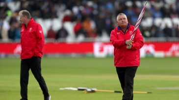 Match umpires Paul Reiffel (left) and Marais Erasmus on a pitch inspection