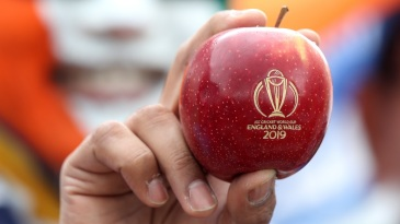 A fan holds up a World Cup apple