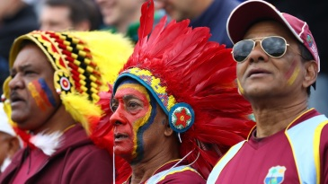 West Indies fans sing their national anthem before the match