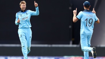 Joe Root celebrates with Chris Woakes after taking the wicket of Shimron Hetmyer