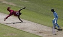 Andre Russell dives for the ball off his own bowling as Joe Root watches on, England v West Indies, World Cup 2019,  Southampton, June 14, 2019