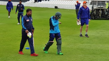 Mushfiqur Rahim walks off the field after a blow to his hand