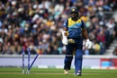 Kusal Perera walks back after getting bowled by Mitchell Starc, Australia v Sri Lanka, World Cup 2019, The Oval, June 15, 2019
