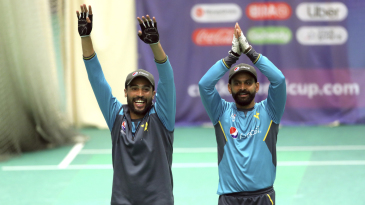 Mohammad Amir and Mohammad Hafeez cheer their team-mates during a nets session