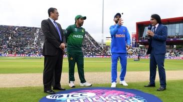 India captain Virat Kohli tosses the coin alongside Pakistan captain Sarfaraz Ahmed