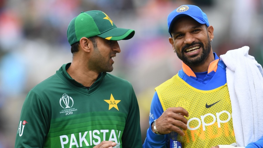 Shoaib Malik and Shikhar Dhawan share a light moment during a drinks break