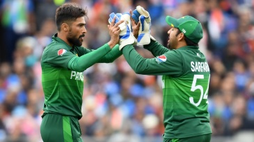 Mohammad Amir celebrates after dismissing MS Dhoni