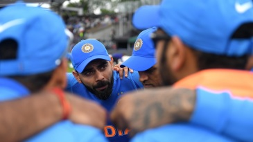 Virat Kohli speaks to the team before the restart