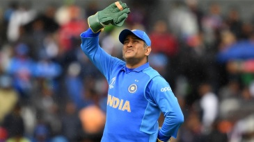 MS Dhoni looks up as light drizzle continues
