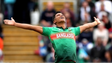 Mohammad Saifuddin celebrates a wicket