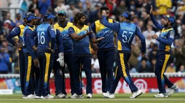 The Sri Lankans celebrate an Australian wicket